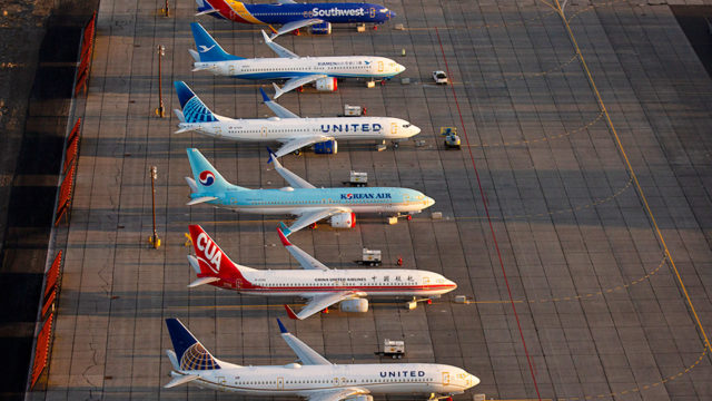 Different colored airplanes next to each other