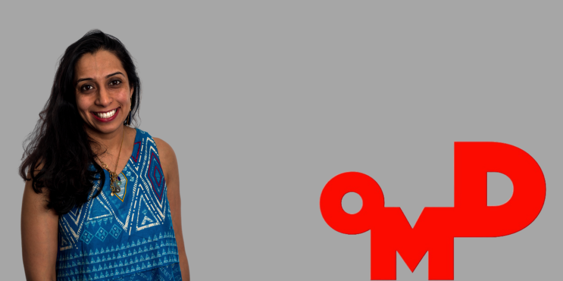 A photo of Shreya Kushari next to the OMD logo