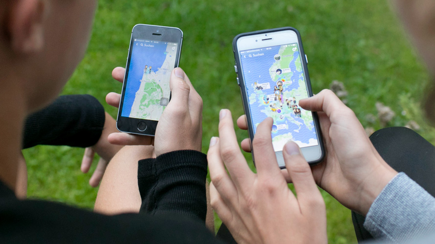 People looking at maps on their smartphones