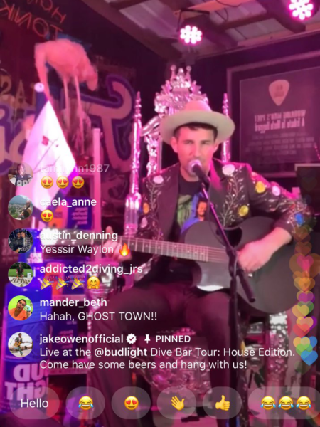 An Instagram live screenshot of a man playing a guitar