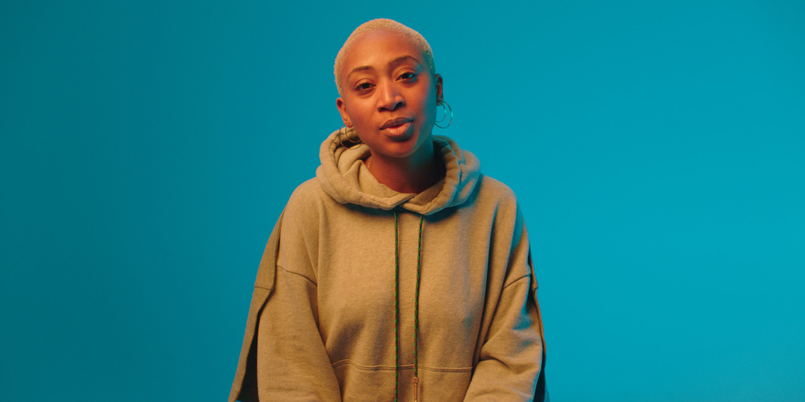 Charlene Prempeh, founder of A Vibe Called Tech, is in front of a blue background.