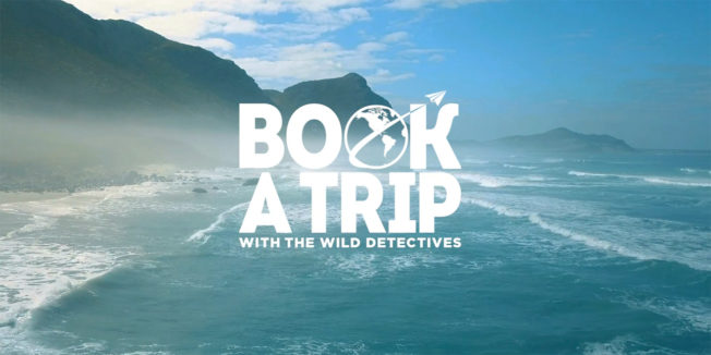 Picture of a beach with text that says, 'Book a Trip With The Wild Detectives'