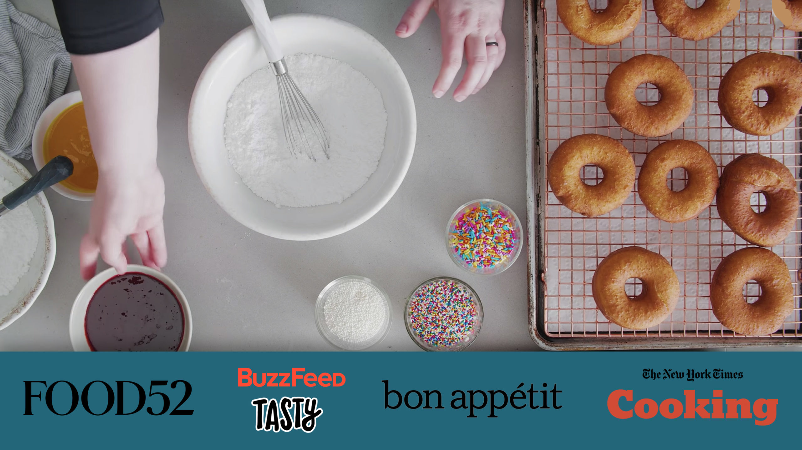 A screenshot from a Bon Appetit video with different company logos from cooking websites