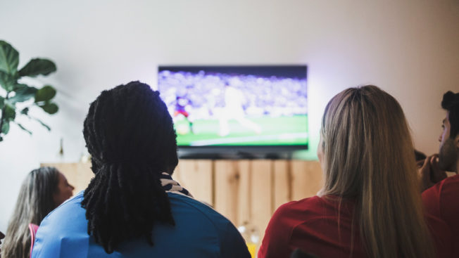 A group of people watching TV