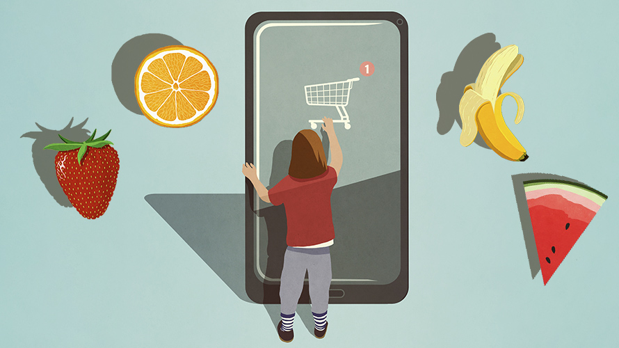 a small person standing in front of a huge phone that has a shopping cart on it with a strawberry, orange slice, watermelon slice and banana floating nearby