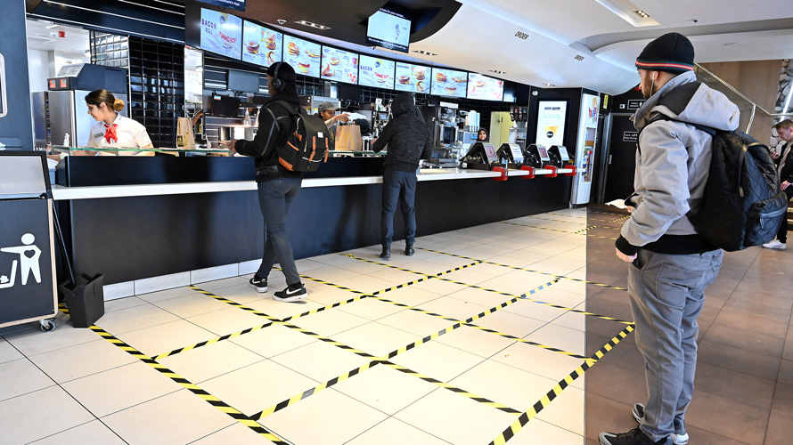 Person waiting in line at a fast-food chain