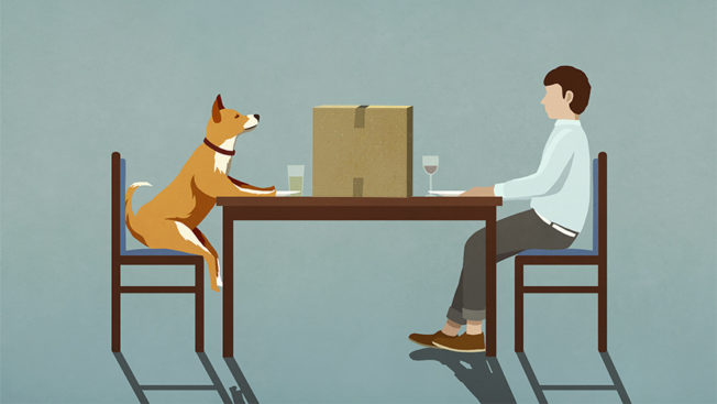 a man and his dog sitting at a table