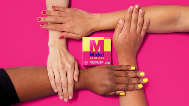 Hands touching one another next to the new Midol logo