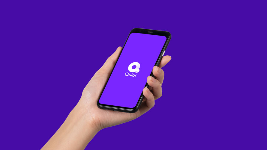 Photo of a purple background with a hand holding a smartphone with the Quibi logo