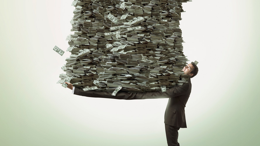 a man holding a giant pile of money