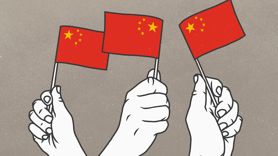 white hands holding small red flags with yellow stars in the corner (chinese flags)