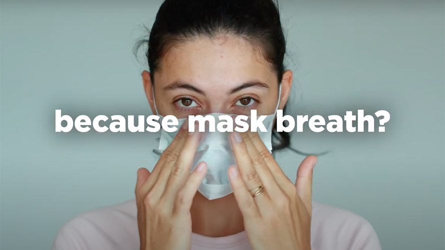 a woman with a face mask that says because mask breath?
