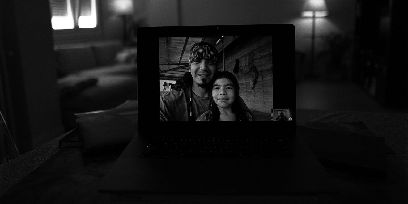photo of a man and woman on a laptop