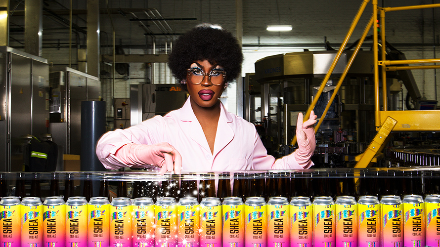 a drag queen filling a bunch of pink and yellow beers
