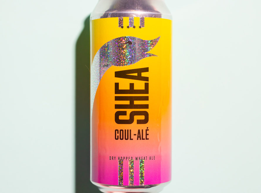 a pink and yellow beer can that says shea coule ale