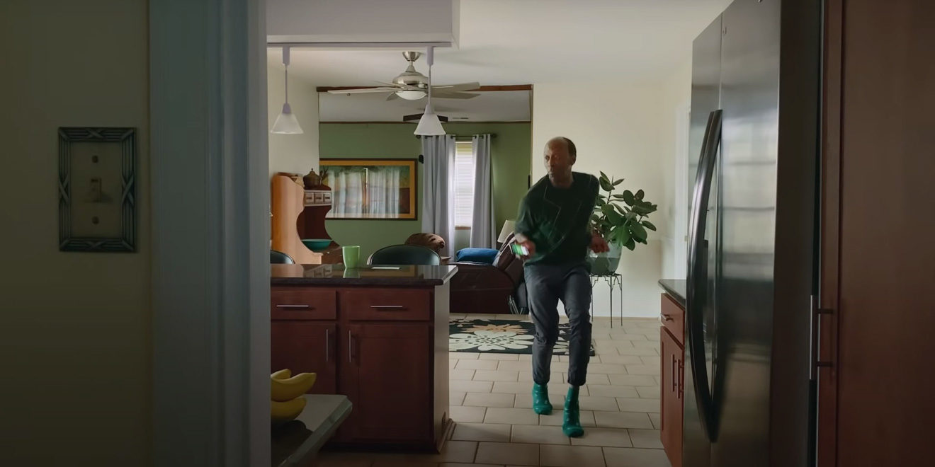 a man dancing in his kitchen