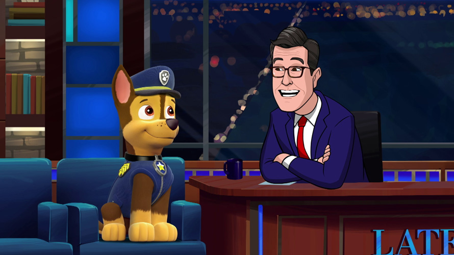 an animated dog and an animated stephen colbert at a desk