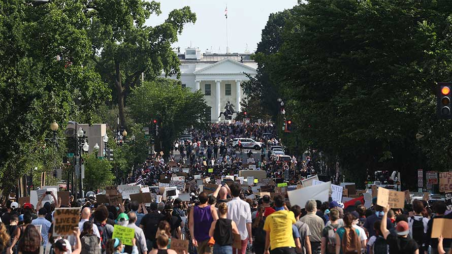 protesters marching toward the white house