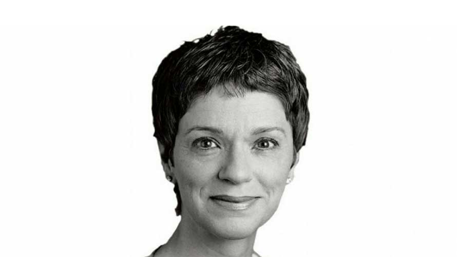 black and white headshot of a woman with short hair