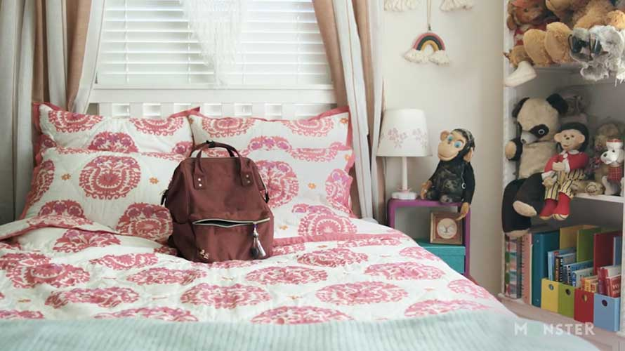 a backpack on a bed