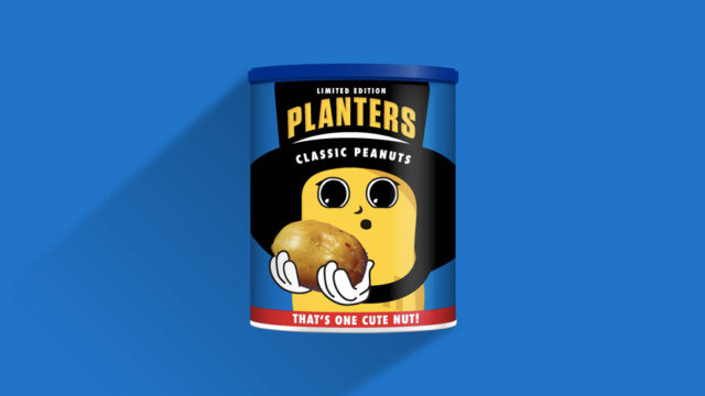 a baby peanut holding a peanut in awe on a planters box