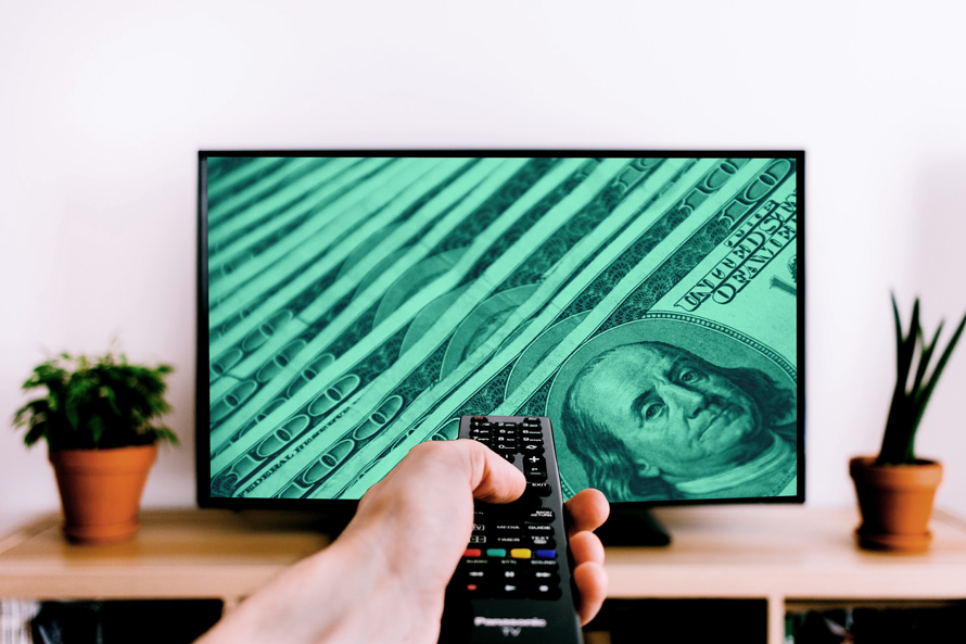 a person pointing a remote control at a tv