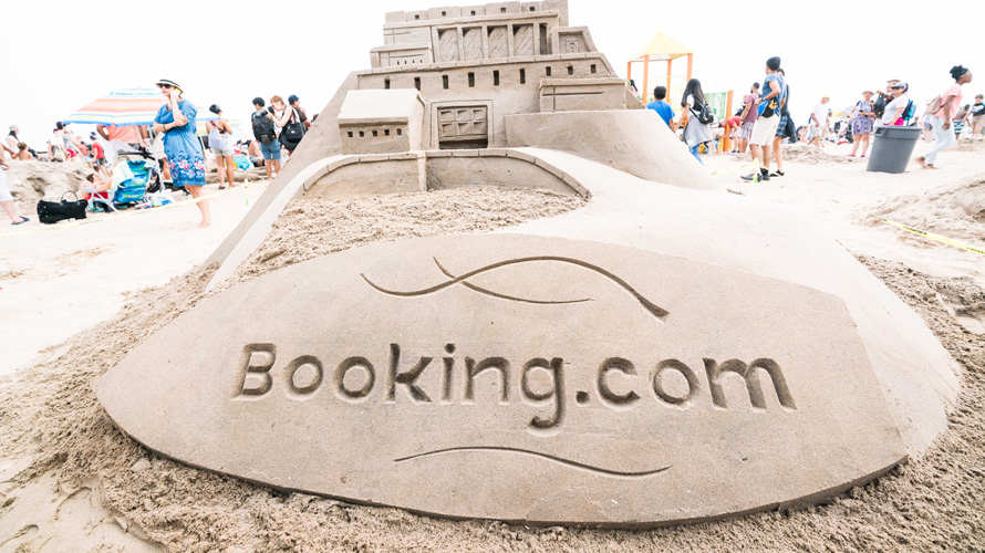 a giant sandcastle that says Booking.com