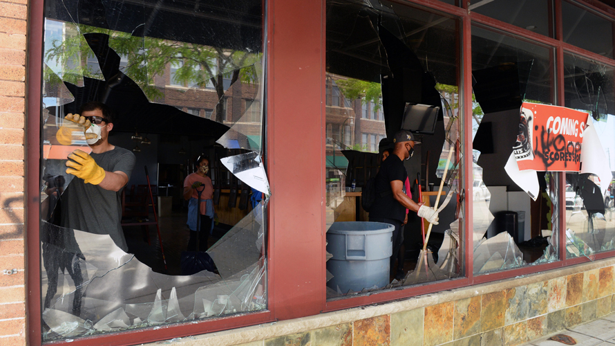 cleaning up broken storefront windows