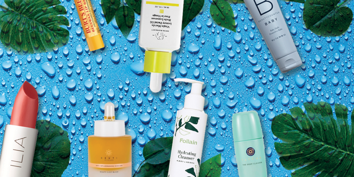 beauty products on a background of water droplets and leaves