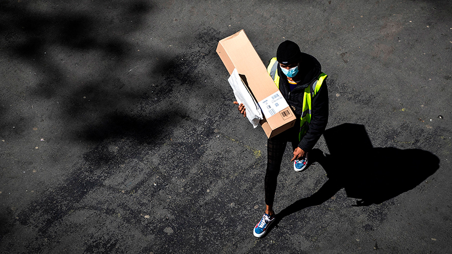 a delivery person carrying a package