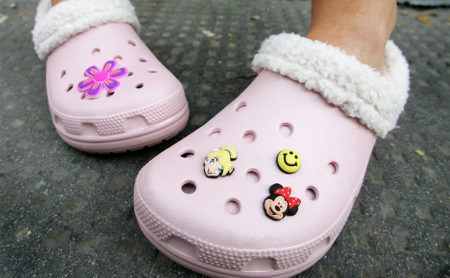 A girl models a pair of Mammoth Crocs outside the first UK Crocs store on October 18, 2007 in London England. Crocs have launched a new Mammoth model for the winter to celebrate the opening of the new store.