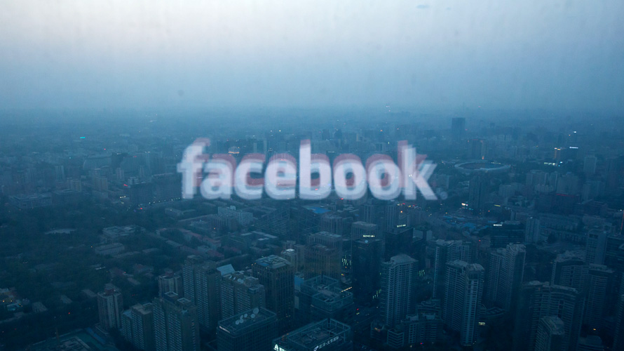 facebook logo over a city landscape