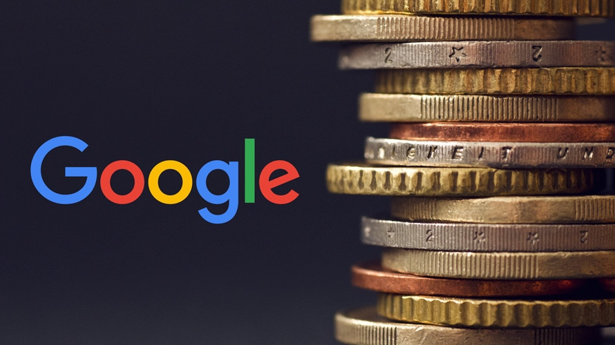 google logo next to a stack of coins