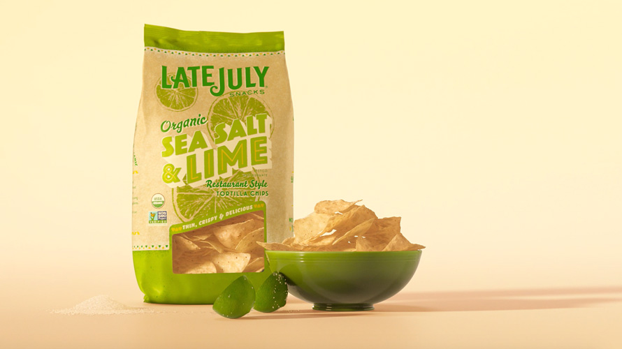 Bag and bowl of Late July lime tortilla chips