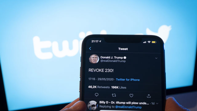 An iPhone open with a tweet from Donald Trump