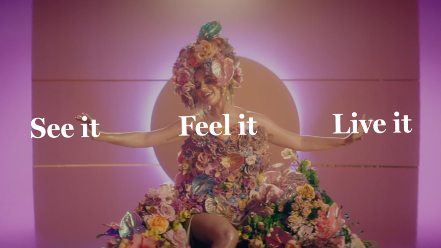 Screenshot of NewFronts presentation with the words 'See it, Feel it, Live it'