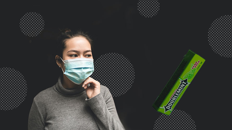 a masked person and a stick of gum