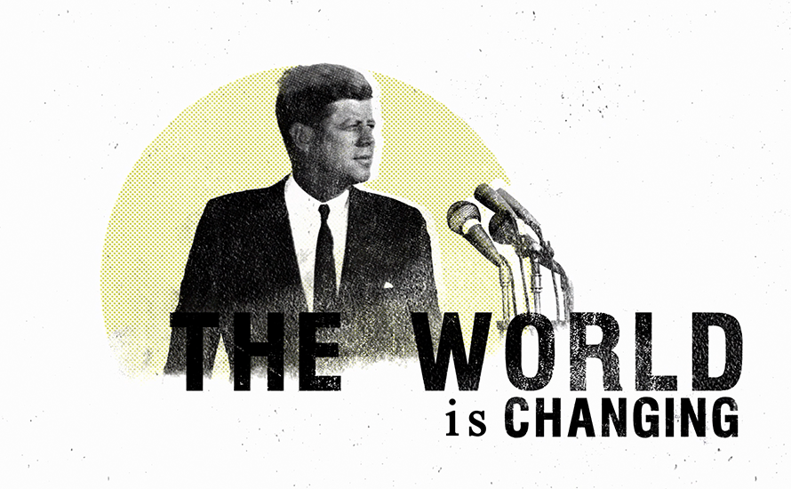 president kennedy speaking into microphones on a yellow circular background with the world The World IS Changing underneath to the right