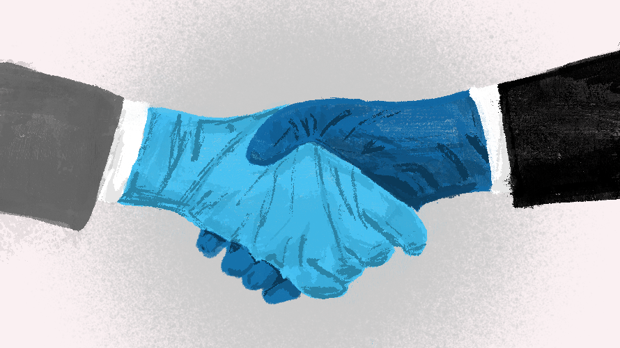 two gloves hands shaking hands
