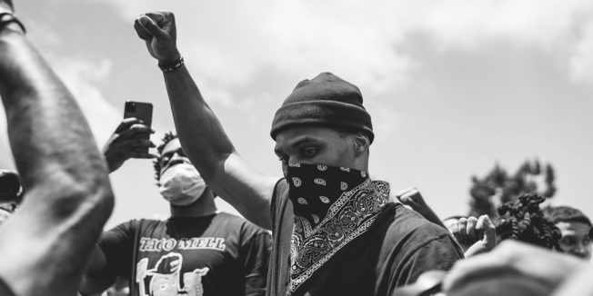 Man with Black power fist up