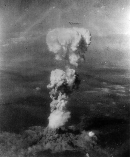 black and white photo of the atomic bombing of hiroshima with smoke in the air