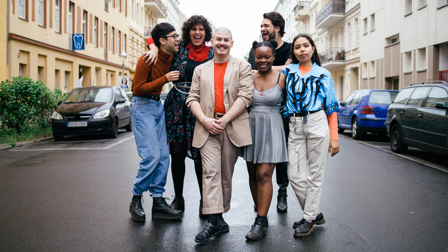 group of mixed race and gendered people in a street