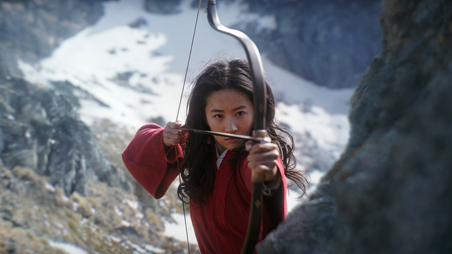 an asian woman holding a bow and arrow in a snowy mountain