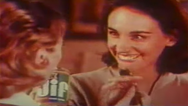 Two moms holding a Jif peanut butter container