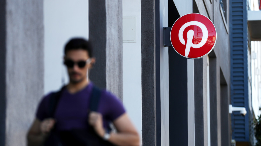 Person walking by the Pinterest logo