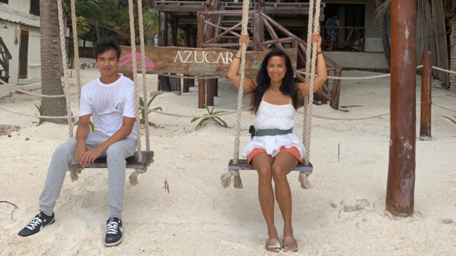Cecilia Pagkalinawan and her son on swings