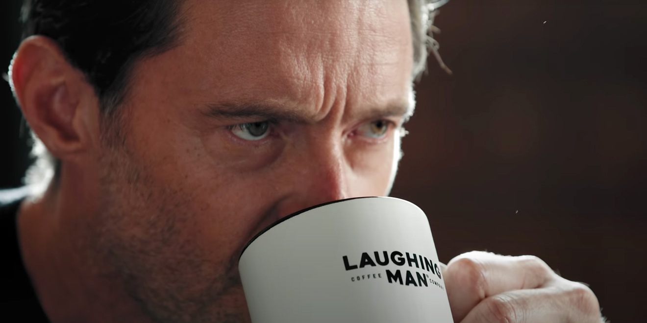 Hugh Jackman drinking coffee