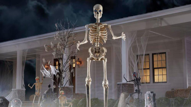 skeleton in front of house