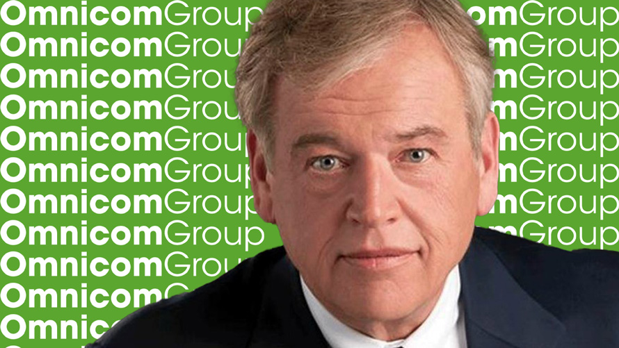 Photo of John Wren and the Omnicom Group logo