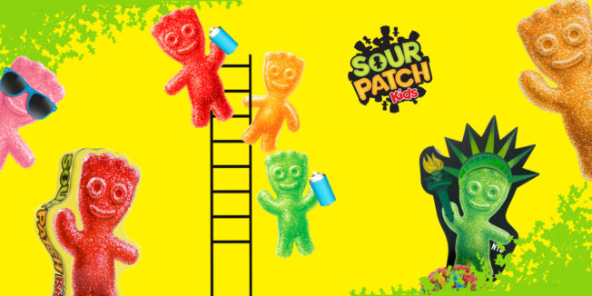 yellow background with colorful sour patch kids climbing around on a ladder